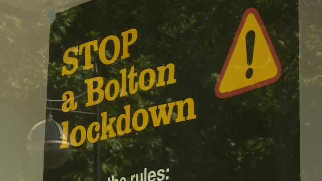"""information signs about restrictions on the local coronavirus lockdown in bolton an area that saw a sharp increase in coronavirus cases - """"bbc news"""" stock videos & royalty-free footage"""