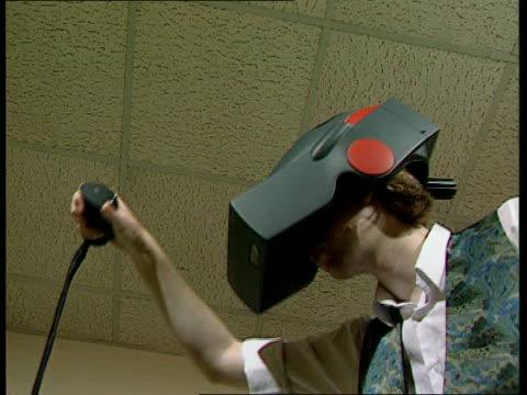 information 'superhighway'; cms man in virtual reality helmet zoom in helmet - reality fernsehen stock-videos und b-roll-filmmaterial