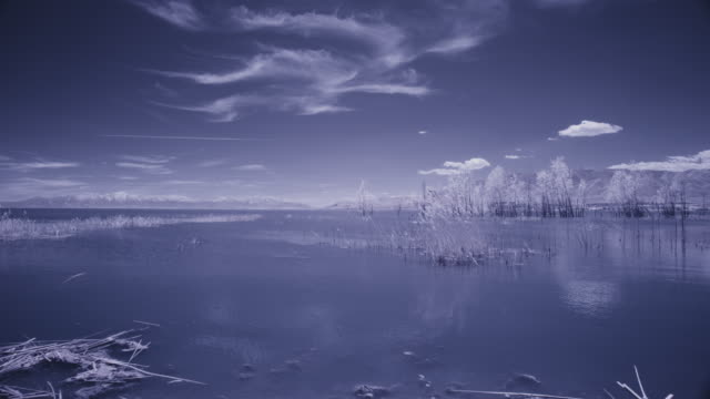 infrared panning shot of clouds over lake / lehi, utah, united states - lehi stock videos & royalty-free footage