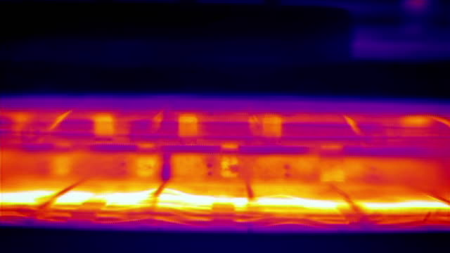 vidéos et rushes de infrared thermal imaging of a toaster toasting a piece of bread - hot