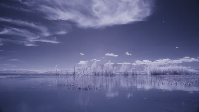 infrared time lapse of clouds passing over lake / lehi, utah, united states - lehi stock videos & royalty-free footage