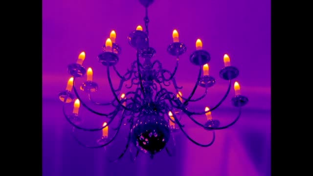 infrared video of a candelabra with the lights on - thermal imaging stock videos & royalty-free footage