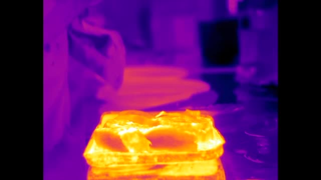 Infrared video of hot food being served up in the kitchen of a pub