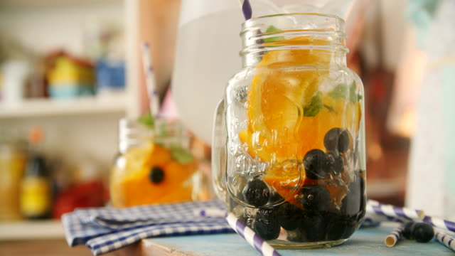 infused water with fresh blueberries and oranges - food state stock videos and b-roll footage