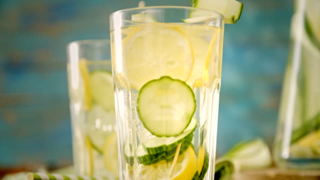 infused water with fresh cucumber and lemon - lemon fruit stock videos & royalty-free footage
