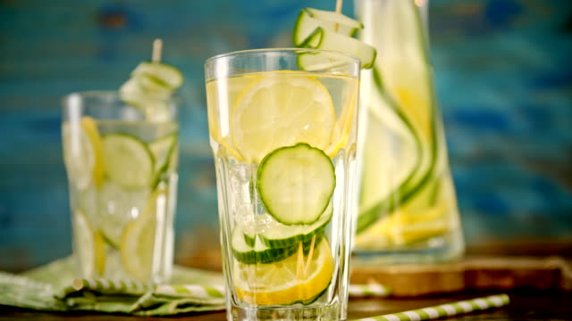 infused water with fresh cucumber and lemon - refreshment stock videos and b-roll footage