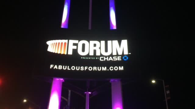 inglewood calif broll of the forum arena lit up in purple for prince wide medium and closeup footage of the building - inglewood video stock e b–roll