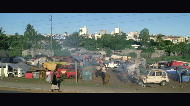 ws tu inhabitant might passing refugees at refugee camp - refugee camp stock videos & royalty-free footage