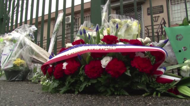 inhabitants of carcassonne in southwestern france lay flowers outside a gendarmerie in honour of lieutenant colonel arnaud beltrame - carcassonne stock videos & royalty-free footage