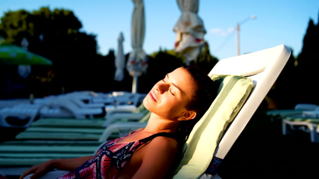 inhaling sun - sunbed stock videos & royalty-free footage