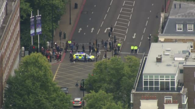 injured after car hits pedestrians near natural history museum; air view police car and police officers in street closed road - pedestrian stock videos & royalty-free footage