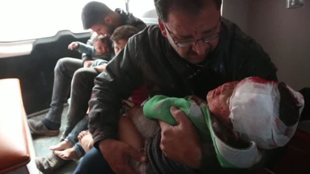 injured children are transported by ambulance to a hospital in the idlib region town of khan sheikhun in war torn syria following regime shelling and... - syria stock videos & royalty-free footage
