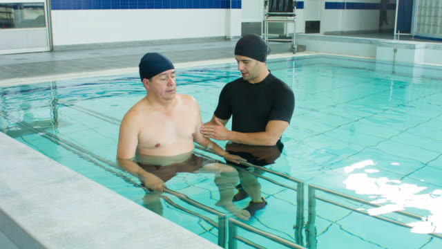 injured man in hydrotherapy - physiotherapy stock videos & royalty-free footage