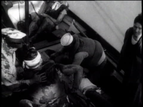 injured men getting onto a life boat / the panay sinking / - 1937 stock-videos und b-roll-filmmaterial