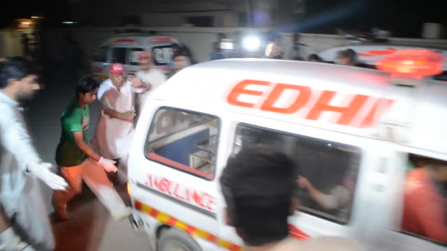 injured pakistani blast victims arrive after being transported to a hospital in the hub district, some 40 kilometers from karachi, on november 12,... - karachi stock videos & royalty-free footage