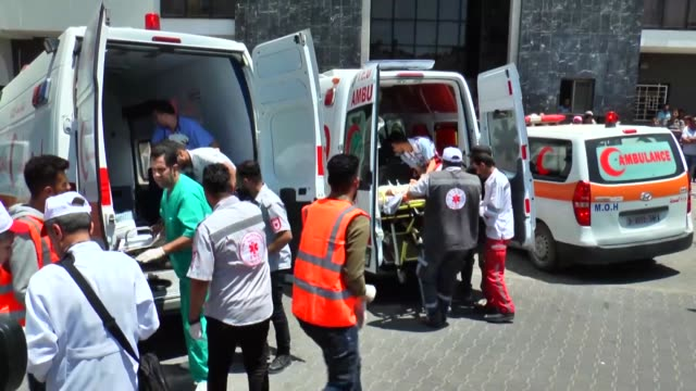 injured palestinians are brought to a local hospital for treatment on may 14, 2018 in gaza strip. at least 37 palestinians were martyred and hundreds... - 70周年点の映像素材/bロール