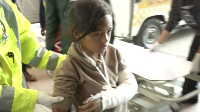 injured people arrive and are treated at bir hospital in kathmandu / a major earthquake hit kathmandu midday on saturday april 25th and was followed... - 退院点の映像素材/bロール