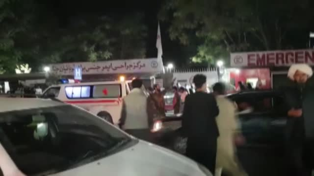 vídeos y material grabado en eventos de stock de injured people being carried to a hospital as unspecified number of casualties reported after two explosions outside hamid karzai international... - kabul
