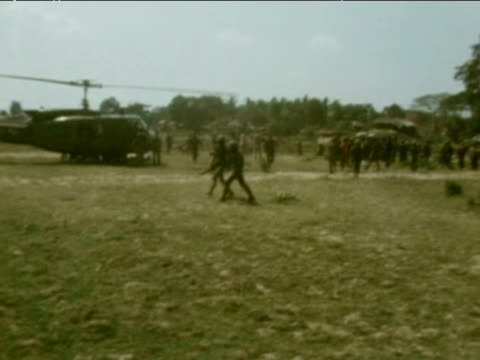 injured refugees are carried by troops to helicopter 1975 - vietnam war stock videos & royalty-free footage