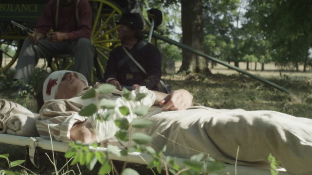 injured revolutionary war solider lying on ground - injured stock videos & royalty-free footage