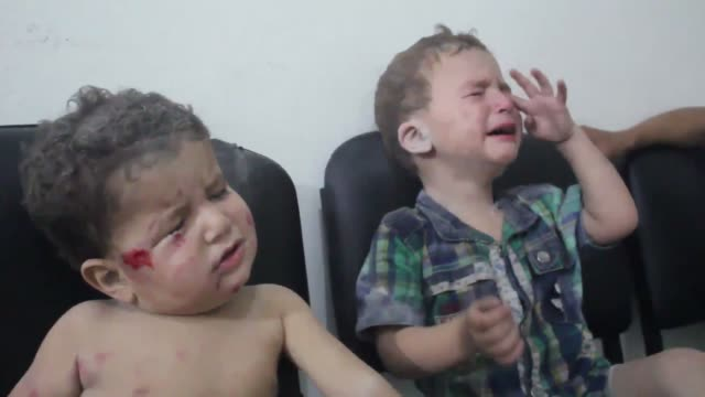 injured syrians receive medical treatment at a hospital following the syrian regime's air strikes which killed eight civilians in the eastern ghouta... - syrien stock-videos und b-roll-filmmaterial