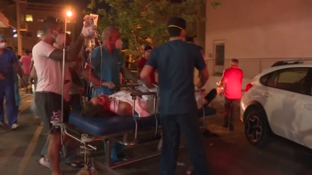 injured victims are transported to a hospital in lebanon following two enormous explosions that rocked beirut's port, killing at least 27 people and... - bombing stock videos & royalty-free footage