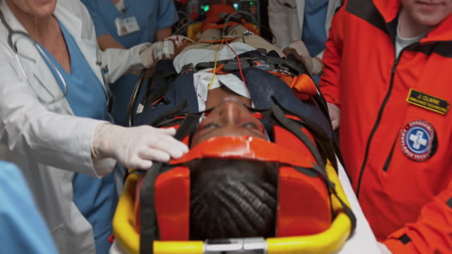 ds injured woman on a spinal board brought to the emergency room - now open stock videos & royalty-free footage