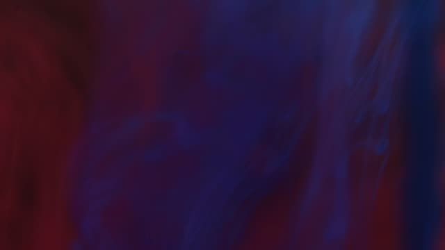 vídeos de stock e filmes b-roll de ink colors dropped in water black background - vermelho