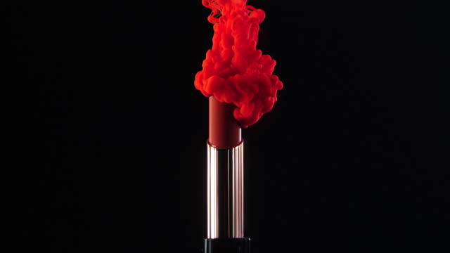 ink drop falling to lipstick with black background in slow motion - make up stock videos & royalty-free footage