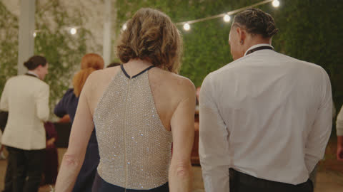 in-laws of the newlywed couple dance with one another at wedding reception - husband stock videos & royalty-free footage