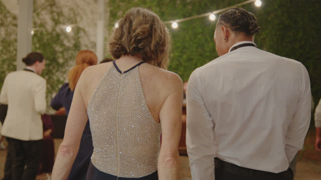 in-laws of the newlywed couple dance with one another at wedding reception - 50 59 years stock videos & royalty-free footage