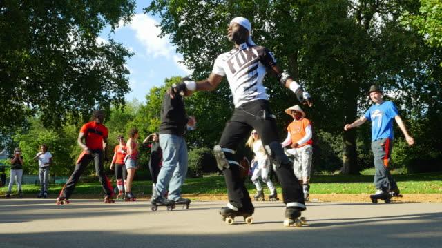 inline skaters meeting in london hyde park - blade stock videos & royalty-free footage