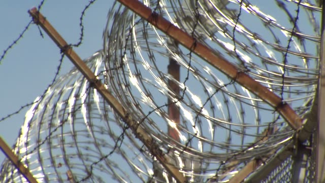 """inmates at the cook county jail watched """"othello the remix"""" performed by the the chicago shakespeare theater. barbed wire fence at cook county jail... - barbed wire stock videos & royalty-free footage"""