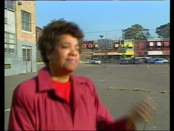 philadelphia:; usa: pennsylvania: philadelphia: ext bv black woman running along pavement and into terraced house v/o child talking about problems... - philadelphia pennsylvania stock videos & royalty-free footage