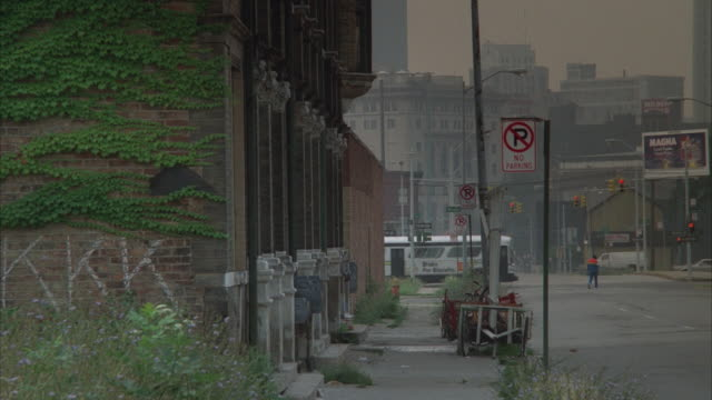 MS, Inner city street with abandoned cars and dilapidated buildings