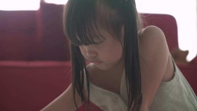 innocence little girl at home - pigtails stock videos & royalty-free footage