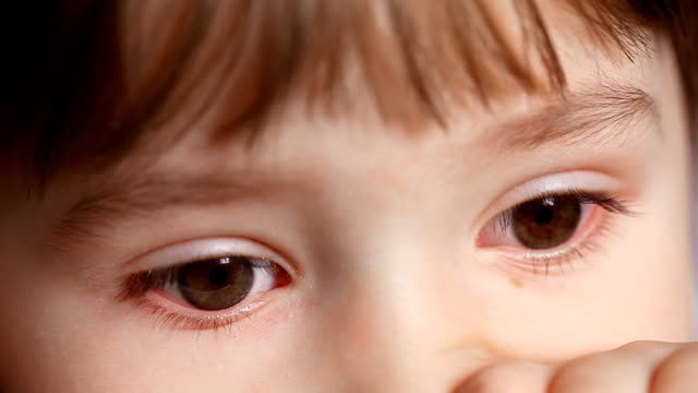 innocent child eyes - sideways glance stock videos & royalty-free footage