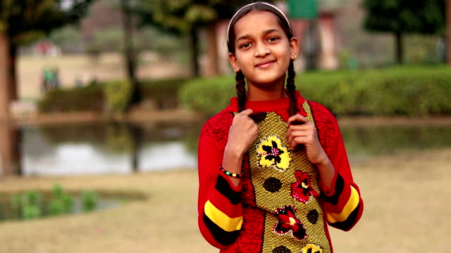 innocent indian little girl portrait - developing countries stock videos & royalty-free footage