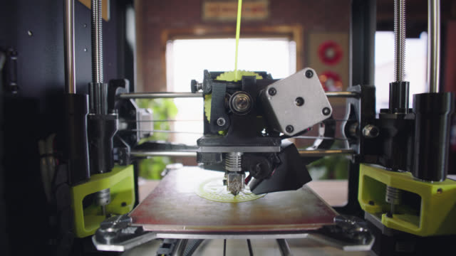 ms. innovative 3d printer creates a three-dimensional wheel with intricate design work. - 3d printing stock videos and b-roll footage
