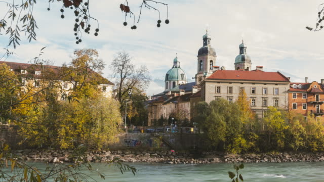 Innsbruck, Austria, beautiful palace and clock tower with tree foreground in Innsbruck Austria