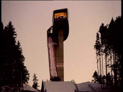 innsbruck ski jump illuminated at night flashing different colours - ski jumping stock videos and b-roll footage