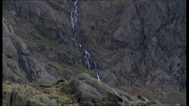 inquest continues into death of chief constable michael todd tx snowdonia ext mountain rockface and landscape around snowdon - snowdonia video stock e b–roll