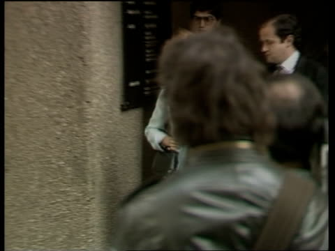inquest into death of roberto calvi ms anna calvi mother and brother carlo calvi down steps from courtpan as anna calvi gets in waiting... - roberto calvi stock videos and b-roll footage