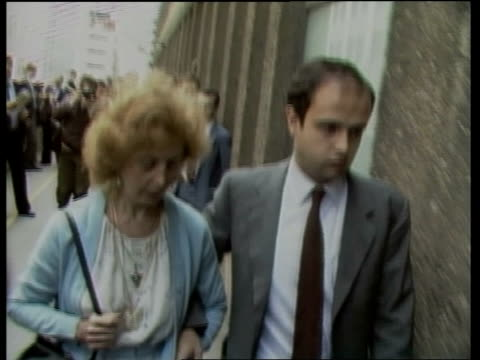 inquest into death of roberto calvi england city of london ms clara calvi wife of murdered banker roberto calvi up steps to court with her family bv... - roberto calvi stock videos and b-roll footage