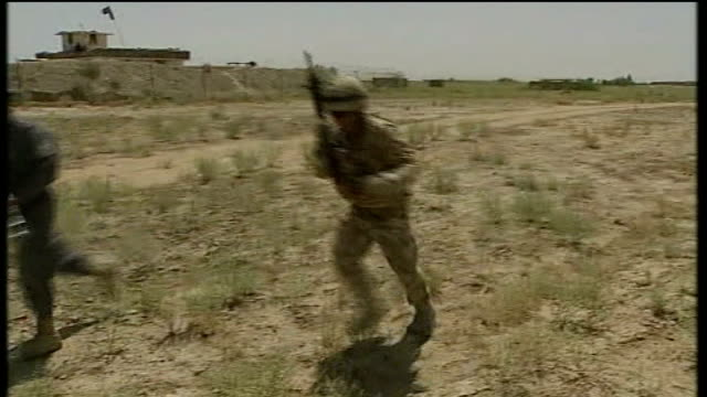 inquest into deaths of soldiers killed by afghan police recruit returns verdict t25031024 date unknown afghan police on training exercise with... - military recruit点の映像素材/bロール