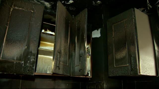 stockvideo's en b-roll-footage met inquest rules that fridge-freezer fire to blame for father's death; merseyside: int various shots of home owner noel davis looking through burnt... - lijkschouwer