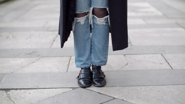 insaf bennis, fashion blogger from sparkles in paris, wears a levi's white t-shirt with a 'paris' logo, levi's blue denim ripped jeans pants, mango... - levi's stock videos & royalty-free footage
