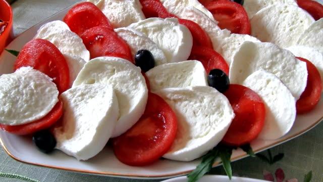 insalata caprese - caprese salad - mozzarella stock videos & royalty-free footage