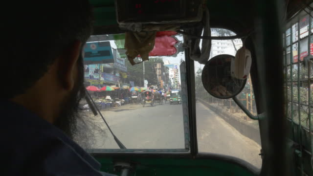 Insane noisy claustrophobic ride within a caged auto-rickshaw across the busy streets of Dhaka Bangladesh