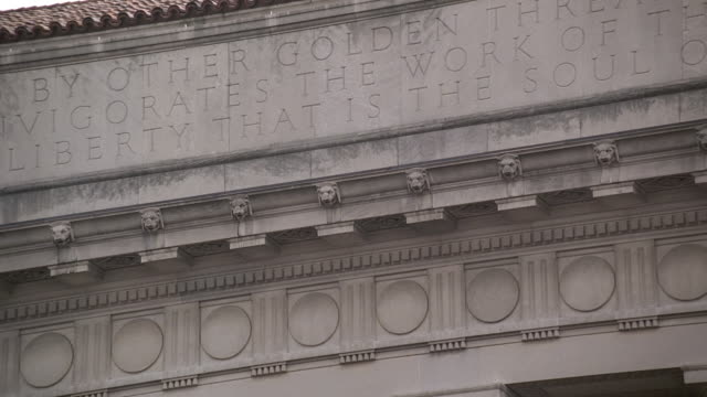 td inscription and detailing above and columns on the herbert c. hoover building / washington, d.c, united states - engraved image stock videos and b-roll footage